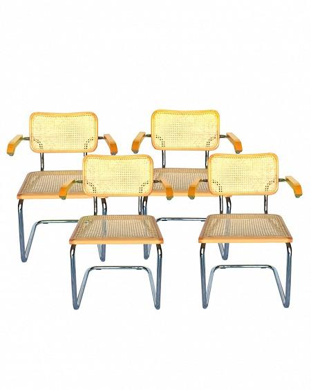 Cuatro sillas con brazos estilo Cesca